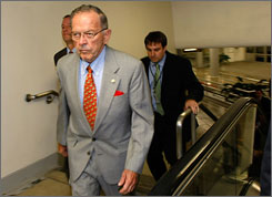 Senate's longest-serving Republican:Ted Stevens walks with aides to a luncheon Tuesday inside the Capitol. Federal agents raided his Alaska home the day before as part of an ongoing public corruption investigation.