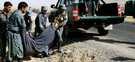The body of Shim Sung-min, 29, is carried to the back of a vehicle by policemen after he was killed by the Taliban militants in Ghazni province, west of Kabul, Afghanistan on Tuesday. Sung-min is the second South Korean hostage slain by the Taliban.