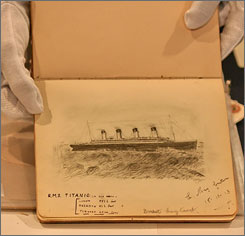 A drawing of the Titanic from an original hand-written account of the disaster by passenger Laura Marie Cribb is shown at a press preview at Christie's in New York, Friday, June 22, 2007. Researchers finally identified a little boy by using dental and DNA samples from his grave and matching them with relatives.