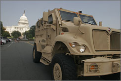 Cougar's competition:MaxxPro, an MRAP being built by International Military and Government, on display near the Capitol. The company ranks second to Force Protection in providing vehicles resistant to deadly IEDs.