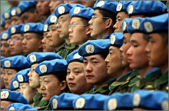 Chinese peacekeepers prepare to depart for Sudan, in January. The U.N. approved a 26,000-strong peacekeeping force in the troubled Sudanese region on Tuesday. The goal of the force is to try to end more than four years of fighting in Darfur.
