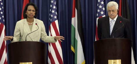 U.S. Secretary of State Condoleezza Rice, speaks as Palestinian Authority President Mahmoud Abbas, right, looks on during a press conference at Abbas' headquarters in the West Bank city of Ramallah , Thursday. Rice met with the entire Palestinian Cabinet on Thursday, a gesture of support for the team of moderates that replaced the Hamas government.