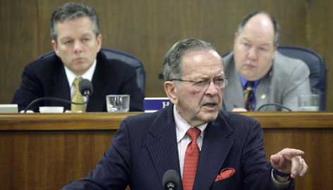 Sen. Ted Stevens addresses a joint session of the Alaska State Legislature at the Capitol in Juneau, Alaska, in this March 2006 file photo. Stevens and his son  Alaska Senate President Ben Stevens, pictured left  are under federal investigation for their ties to the oil services company VECO Inc.