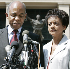 U.S. Rep. William Jefferson, D-La., speaks to the press outside U.S. District Court after arraignment proceedings against him in Alexandria, Va., on June 8, 2007. To his left is his wife, Dr. Andrea Green Jefferson.