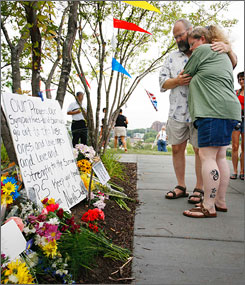 Stephen and Patricia Sudbeck of Waconia, Minn., traveled the 35 miles to Minneapolis to leave a card at a memorial in the Gold Medal Park for the victims of the Interstate 35W bridge collapse.