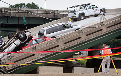 FBI agents investigate the scene of the I-35W bridge collapse Monday in Minneapolis. The estimated cost of debris removal is set at $15 million, and officials warned that it could be a slow process. At least four cranes will be used to remove vehicles and remnants of the 1,900-foot span.