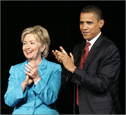 Democratic presidential hopefuls, Sen. Barack Obama, D-Ill., right, applauds with Sen. Hillary Rodham Clinton, D-N.Y., after they participated in the Yearly Kos Convention's Presidential Leadership Forum in Chicago.