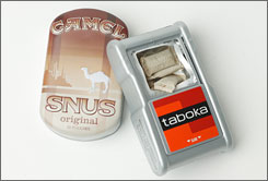 Camel Snus and Philip Morris' Taboka are two types of smokeless, spitless tobacco products.