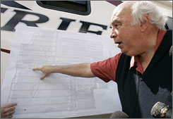 Robert E. Murray, founder and chairman of Cleveland-based Murray Energy Corp, points on a map to where six trapped coal miners are believed to be at at the entrance to his Crandall Canyon Mine in Utah on Monday.