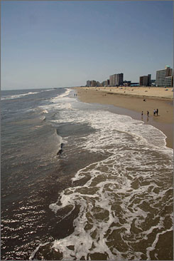 Visitors walk the shore at Virginia Beach, where 24 testing sites are monitored once a week to guard against contamination. A new report finds that the nation's beaches are increasingly vulnerable to contamination.
