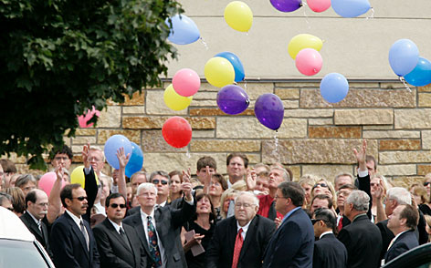 Family and friends release balloons after the funeral service for Sherry Engebretsen, Wednesday, in Shoreview, Minn. Engebretsen, 60, called her daughter Jessica at 5:39 p.m. the evening of the collapse to say that she was leaving work to return home. It was their last conversation.