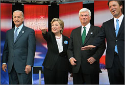 Democratic presidential candidates Joe Biden, far left, Hillary Rodham Clinton, Chris Dodd and John Edwards are introduced prior to a Presidential Forum hosted by the AFL-CIO in Soldier Field in Chicago.