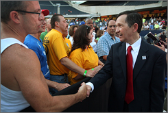 Democratic Presidential candidate Rep. Dennis Kucinich greets members of the audience following a presidential forum hosted Tuesday by the AFL-CIO in Chicago. Approximately 15,000 people attended the event.