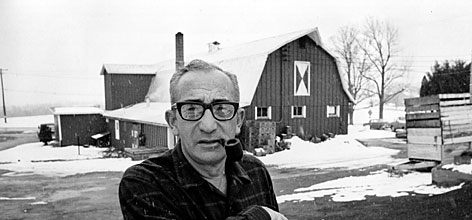 Max Yasgur poses at his farm near Bethel, N.Y. in this March 23, 1970 file photo. The famous Woodstock homestead is on the market for $8 million.