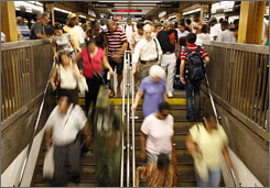 Passengers leave a subway platform at the 34th Street station in Manhattan on Wednesday. The black population of New York City and other major metro centers slipped in 2006 as more African-Americans move to the suburbs.
