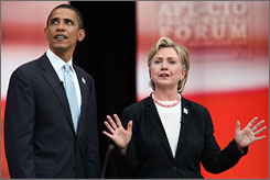 Sen. Barack Obama and Sen. Hillary Rodham Clinton chat following a Democratic presidential forum hosted by the AFL-CIO at Chicago's Soldier Field on Tuesday. The debate featured a dustup over foreign policy and Obama's discussion of nuclear weapons.