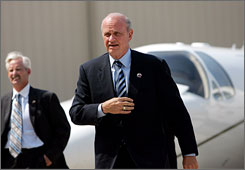 Fred Thompson, seen here at Dallas Love Field Airport in July, plans to make his first Iowa campaign trip next week.
