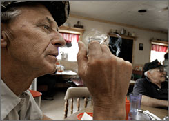 Mike Spent smokes a cigarette after a meal in Decatur, Ill., in May. Higher taxes have cut the consumption of cigarettes, a USA TODAY analysis shows.