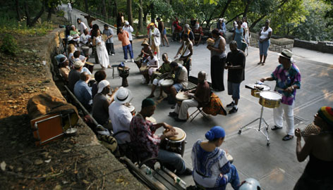 African-style drummers who have met for decades in Marcus Garvey Park in the Harlem neighborhood of New York take part in their Saturday night drum circle on July 28, 2007.
