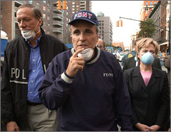 Then-governor of New York George Pataki, left, then-mayor Rudolph Giuliani, center, and Sen. Hillary Rodham Clinton tour the site of the World Trade Center disaster in this Sept. 12, 2001, file photo.