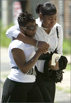 Attendees grieve while leaving the funeral services for Terrance Aeriel in Newark on Saturday.