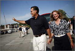Former Massachusetts governor Mitt Romney and his wife Ann greet voters at the Iowa Straw Poll Saturday in Ames, Iowa. An estimated 40,000 people were expected to attend and take part in the poll.