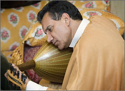 Haj Youness plays a Moroccan instrument called a oud on in Casablanca, Morocco. This month's performance will feature music and instruments unique to the different cultures involved.