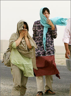 Two of the released South Korean hostages are seen after they were released by Taliban in Ghazni province on Monday.