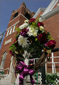 A memorial wreath stands in front of the First Congregational Church in Neosho, Mo., Monday. A shooting at the church Sunday left three dead and five injured.