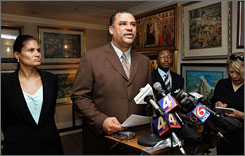 New Orleans City Council member Oliver Thomas, center, speaks at a press conference with his attorney Clarence Roby Jr., right, and his wife Angelle Thomas, left, as he announces his resignation in New Orleans, Monday.