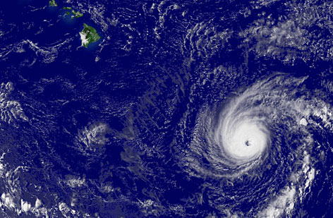 Hurricane Flossie, right, and Hawaii, top left, are seen in this handout image provided by the National Oceanic and Atmospheric Administration (NOAA). Meteorologists expect the storm to come within 100 miles of the Big Island. 