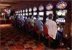 Pennsylvania legalized slot machines  such as these at Philadelphia Park Casino and Racetrack in Bensalem, Pa.  last year and reaped $300 million in tax revenues in the first seven months of this year. Six stand-along casinos are on the way.