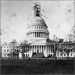 This image shows the work on the top of the U.S. Capitol dome, where the statue of Freedom stands. The image is circa June-December 1863.