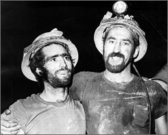Tom Wilkinson, left, and Ron Flory beam after being rescued from the Sunshine Mine fire in May 1972, in Kellogg, Idaho