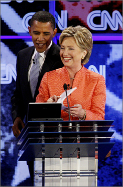 Sen. Hillary Clinton speaks with Sen. Barack Obama after the CNN/YouTube debate on July 23 at the Citadel Military College in Charleston, S.C.