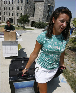 Freshman Sarah Brock gets a hand Wednesday from her brother, Taylor, a Tech junior.