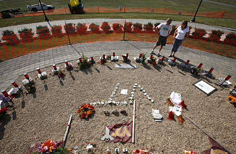 Thirty-two stones serve as a memorial to the Virginia Tech students and faculty who were killed in the April 16 massacre. Tech President Charles Steger will unveil a new arc of 32 300-pound stones Sunday.