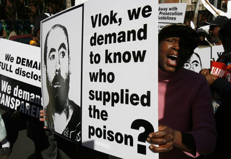 South African protesters demanded justice ahead of apartheid-era police minister Adriaan Vlok's court appearance on charges of attempting to murder anti-apartheid activist Reverend Frank Chikane by poisoning his underwear in 1989. Vlok, his former police chief Johann van der Merwe, and three lower-ranking policemen faced charges. Vlok pleaded guilty Friday morning.