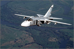 """A Russian Su-24 medium-range bomber, known by NATO as """"Fencer,"""" flies somewhere at undisclosed location in Russia."""