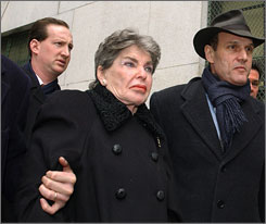 "Helmsley, center, in a 2003 photo. She became a household name in 1989 when she was tried for tax evasion, and a former housekeeper testified that she heard Helmsley say: ""We don't pay taxes. Only the little people pay taxes."""