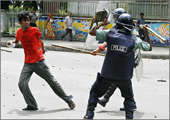 Riot policemen beat a student of Dhaka university during a clash.