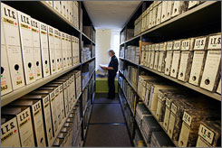 A woman works in the archive at the International Tracing Service (ITS) in Bad Arolsen, Germany, Thursday, Nov. 9, 2006. The ITS contains the fullest records of Nazi persecutions in existence. The Associated Press has been given repeated access to the archive in Bad Arolsen in recent months.