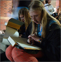 Tonya Ross, 15, left, and Sarah Jarvis, 14, read Harry Potter and the Deathly Hallows in Racine, Wisconsin. Who are the 27% of people the poll found hadn't read a single book this year? Nearly a third of men and a quarter of women fit that category. They tend to be older, less educated, lower income, minorities, from rural areas and less religious.
