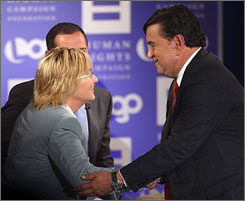 New Mexico Gov. Bill Richardson, right, greets singer and panelist Melissa Ethridge, left, at the gay issues presidential forum on August 9 in Los Angeles.