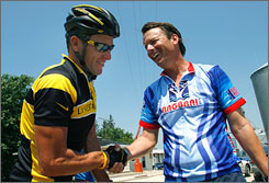 Lance Armstrong, left, and John Edwards, right, shake hands after the Register's Annual Great Bike Race Across Iowa in July. Armstrong's foundation is hosting a cancer forum next week for presidential candidates.