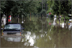 Many streets in Ottawa, Ohio were covered with water on Friday. Officials blamed flooding for for two deaths in northern Ohio.