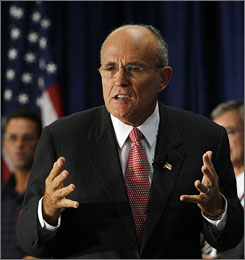 Republican presidential hopeful Rudy Giuliani talks about his tax plan during a campaign stop in Manchester, N.H.