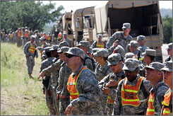 A large group of U.S. Army soldiers are briefed by supervisors as they prepare to assist in the search and rescue efforts for Sgt. Lawrence G. Sprader at Fort Hood, Texas, in this June 12, 2007, file photo.