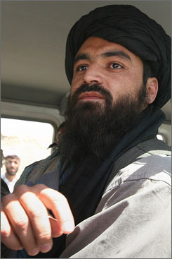 Taliban representative Qari Bashir, seen in the vehicle of the International Committee of the Red Cross, heads to the Afghan Red Crescent Society in Ghazni province, where Taliban and South Korean delegations discussed the fate of 19 South Korean hostages.