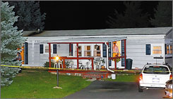 An investigator can be seen through the front door at the scene of a murder Monday, near Greencastle, Pa. Paul Devoe III confessed to shooting Betty Jane Dehart, 81, after pulling off the Interstate and seeing her seated outside her home.